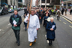 Hundreds of Christians in London take part in the interdenominational Methodist, Anglican and Catholic March of Witness in Westminster. PICTURED: Scores of Christians walk in a solemn procession, following the cross as it is carried along Victoria Street towards Westminster Cathedral