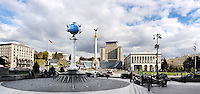Travel panoramic stock photo of Independence Square Maydan Nezalejnosti in Kiev Ukraine Globus statue globe on a column on the front and a monument of with a woman symbol of Ukraine and The Ukrainian National Tchaikovsky Academy of Music and Ukraine hotel on the back September 2007 The original size of this image is 10000 pixels by the longest side