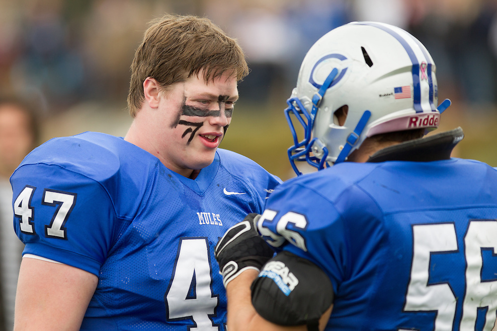 Mike Wincek and Caleb Harris, of Colby College, in a NCAA Division III football game against Bates College on October 26, 2013 in Waterville, ME. (Dustin Satloff/Colby College Athletics)