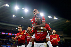 CARDIFF, WALES - Saturday, December 22, 2018: Manchester United's Paul Pogba celebrates with team-mate Ashley Young after the FA Premier League match between Cardiff City FC and Manchester United FC at the Cardiff City Stadium. Manchester United won 5-1.(Pic by Vegard Grøtt/Propaganda)