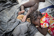 Refugee children sleeping in the shadow with thier puppy during the warm afternoon. Many children in the area are severely sick due to Malaria, which is one of the biggest factors in the mortality rates in the country.The central African rep. has some of the world's worst child welfare indicators. The infant mortality rate is 112, and out of 1,000 children born in CAR, 171 will die before reaching the age of five. The five main child killers in CAR are malaria, diarrhoea, acute respiratory infections, malnutrition and measles – all preventable diseases. The Accelerated Child Survival and Development Strategy UNICEF is implementing aims to reach every newborn and child in every district with a set of priority interventions. Evidence shows that there are a number of known and affordable interventions that if implemented fully could prevent 63 per cent of current childhood mortality.