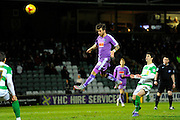Plymouth Argyle's Graham Carey putting a headed shot over the bar during the Sky Bet League 2 match between Yeovil Town and Plymouth Argyle at Huish Park, Yeovil, England on 23 February 2016. Photo by Graham Hunt.