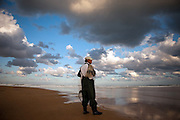 Korean fisherman at the Korean East Sea Coast during a late afternoon with a cloudy sky panorama / Hwajinpo, South Korea, Republic of Korea, KOR, 08 October 2009.