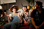 """Shem Hanks and Travis Bertram, left and center, have a hearty laugh alongside Phil Hanks, right, during a rehearsal for """"Aunt Polly's Demise-A Hillbilly's Demise"""" at Family Worship Center on Tuesday."""