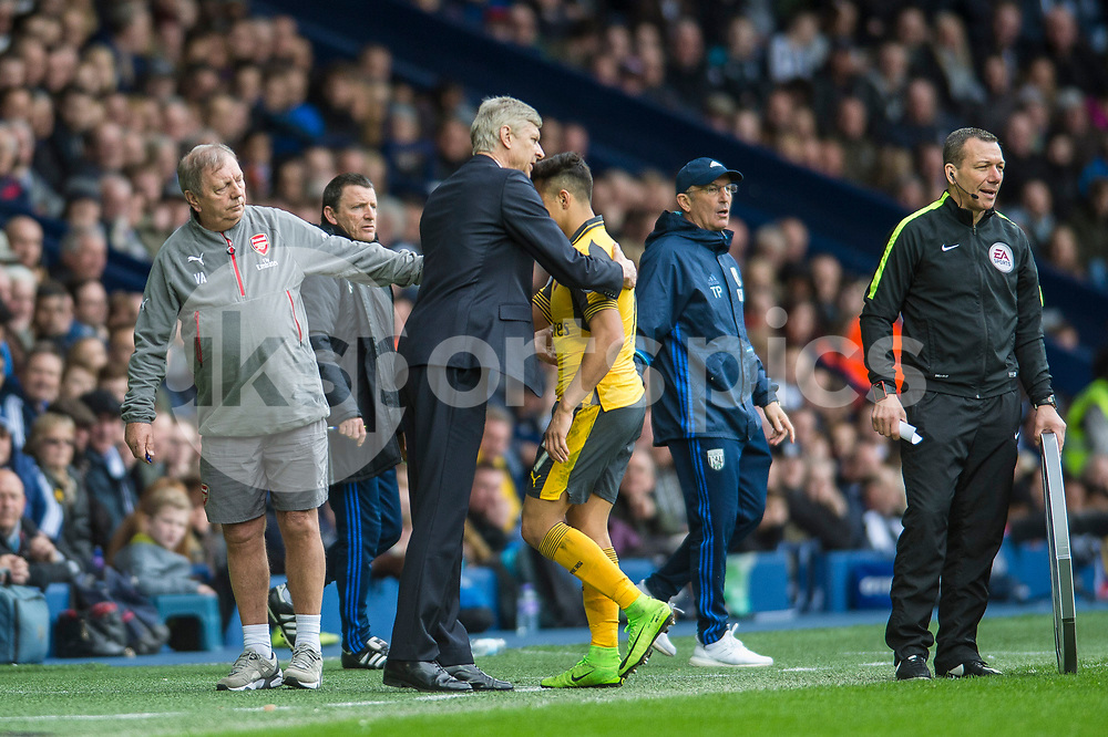 Alexis Sánchez of Arsenal is substituted during the Premier League match between West Bromwich Albion and Arsenal at The Hawthorns, West Bromwich, England on 18 March 2017. Photo by Darren Musgrove.