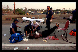 29th August, 2005. Hurricane Katrina hits New Orleans, Louisiana. An injured man from the lower 9th ward is treated for his injuries. The lower 9th suffered catastrophic flooding.