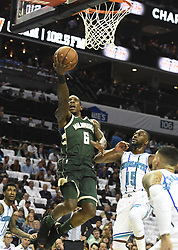 October 17, 2018 - Charlotte, NC, USA - The Milwaukee Bucks' Eric Bledsoe (6) drives in past the Charlotte Hornets' Kemba Walker (15) during the first half at the Spectrum Center in Charlotte, N.C., on Wednesday, Oct. 17, 2018. (Credit Image: © David T. Foster Iii/Charlotte Observer/TNS via ZUMA Wire)