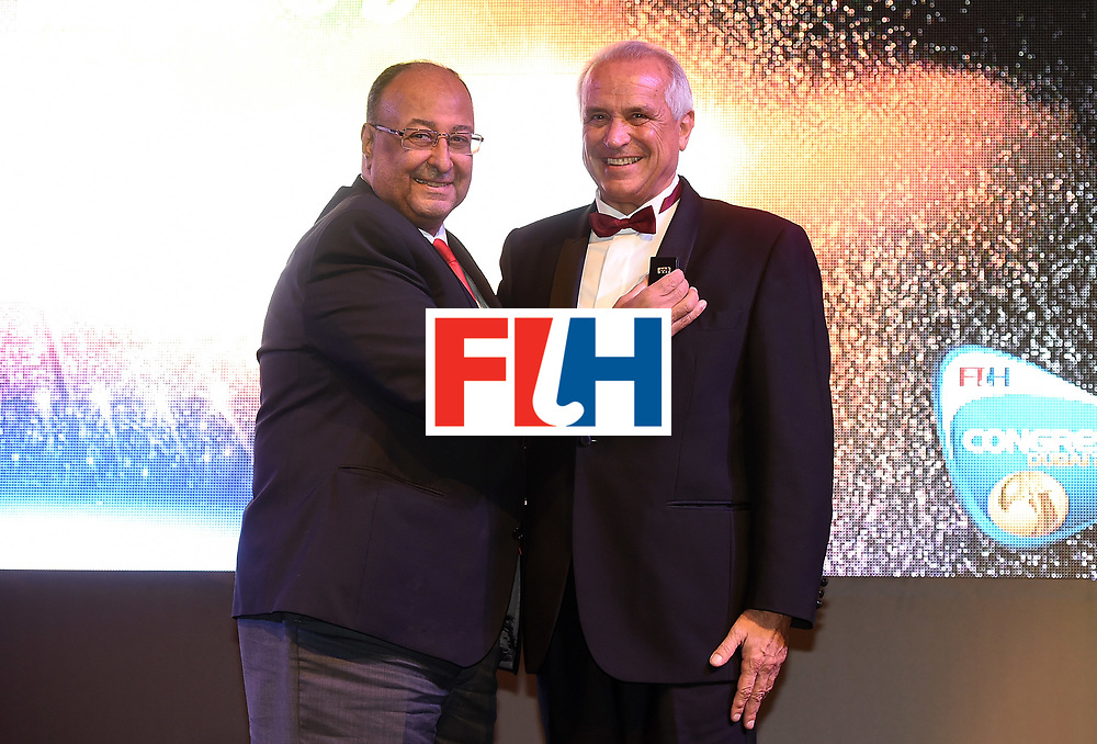 DUBAI, UNITED ARAB EMIRATES - NOVEMBER 11:  Leandro Negre recieves the President of Honour from Seif Ahmed at the Hockey Revolution Part 2 No Limits Ball on November 11, 2016 in Dubai, United Arab Emirates.  (Photo by Tom Dulat/Getty Images)