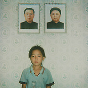 NORTH KOREA POLAROIDS<br /> <br /> Photographer Eric Lafforgue first went in North Korea in 2008. At this time, there was no mobile phone in the country, and the only pics people were taking were thanks to the official photographers who stood at the entrance of the main monuments, to sell some photo souvenirs to visitors. <br /> 	<br /> I first thought about making Polaroids just as a kind of artistic work, to keep the dull colors of this country, but quickly i discovered this camera was the best way to make contacts with locals and to break the ice.<br /> <br /> Everytime i was taking a polaroid, i was taken another one i offered to my north korean &laquo;&nbsp;model&nbsp;&raquo;.<br /> <br /> So many times, this allowed me to see north koreans in a very different way, and to start some conversations, thru my guide, of course. Something that was no allowed in 2008.<br /> <br /> I think the ones who loved the most the Polaroids were the soldiers&nbsp;! At the DMZ, the whole unity stood one by one in front of the camera. First the colonel did not want to allow me to disturb the mission they had&nbsp;: monitoring South Korea. But when i did one of a soldier, he came back and ordered me to take one for him&nbsp;!<br /> Another colonel lead me to the top of the DMZ building to pause&nbsp;: he wanted to show his wife where he was working.<br /> It was so funny to see them lose the stiff attitud they are supposed to keep everytime.<br /> <br /> When visiting some houses, i asked the people where they wanted to stand for the picture, everybody answered &laquo;&nbsp;below the dear leaders&nbsp; portraits&raquo;. Once, i had to do the Polaroid again as the Leaders portraits were cut. Unacceptable.<br /> <br /> For many, they had never see the development of a Polaroid, specially in the countryside where the only pics people own are the ones of the Dear Leaders (an obligation by the way&nbsp;!). So when i gave Polaroids to farmers, they were really happy. One of them even offered me 1 peach to thank me. In 2008, it was a very valuable gift for a north korean. They were the first fruits i saw in  my15 days tour&hellip;<br /> <br /> In Pyongya