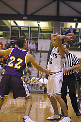 14 December 2002:  Chris Silagi during an NCAA Division 3 basketball game between the Olivet Nazarene Tigers and the Illinois Wesleyan Titans at Shirk Center in Bloomington Illinois.