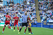 Sheffield Wednesday forward Atdhe Nuhiu (17) looks to head the ball in front of Fulham defender Joe Bryan (23)  during the EFL Sky Bet Championship match between Sheffield Wednesday and Fulham at Hillsborough, Sheffield, England on 21 September 2019.