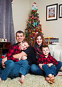 The Kirby family pose for a Christmas photo session at their home in Morgantown, West Virginia.