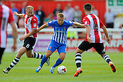 Hartlepool United midfielder Nicky Featherstone (4) flanked by Exeter City forward Robbie Simpson (8) and Exeter City midfielder Lloyd James (4) during the EFL Sky Bet League 2 match between Exeter City and Hartlepool United at St James' Park, Exeter, England on 13 August 2016. Photo by Graham Hunt.