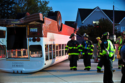 Emergency personnel work to free students trapped in a Lehigh University school bus following a crash on  Tuesday, October 27th, 2015, on Route 22 in Bethlehem, Pa. (AP Photo/Chris Post)