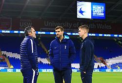 Tottenham Hotspur's Fernando Llorente (centre) and Juan Foyth (right) before the Premier League match at Cardiff City Stadium, Cardiff.