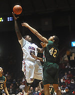 """Ole Miss guard Nick Williams (20) shoots over Mississippi Valley State's Jason Holmes (42) at C.M. """"Tad"""" Smith Coliseum in Oxford, Miss. on Monday, December 13, 2010."""