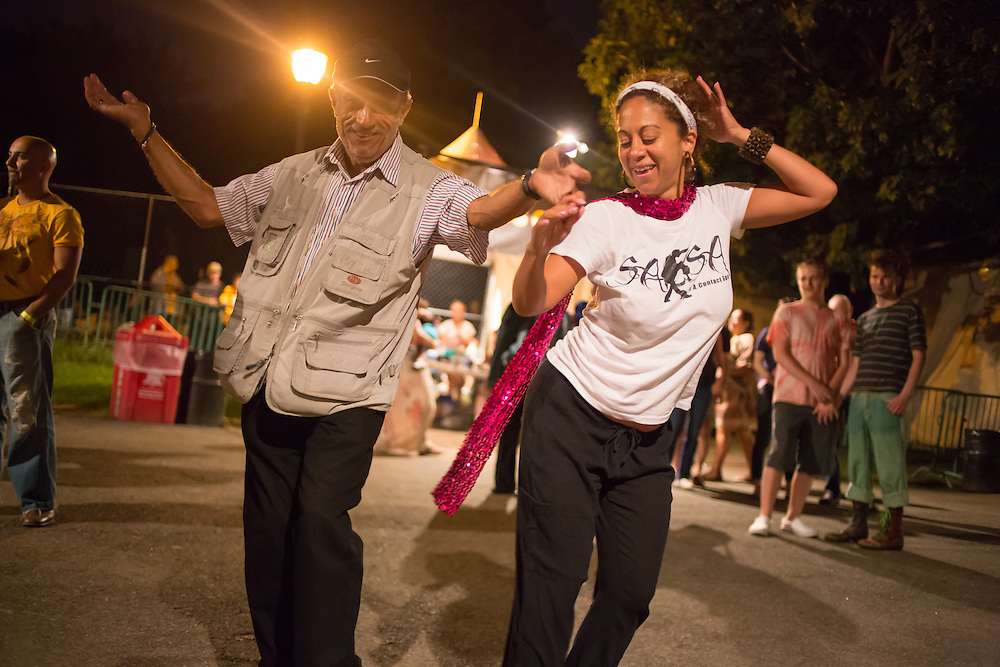 A man and a woman dance near the entrance gate at the Prospect Park bandshell to Palmieri's salsa music.