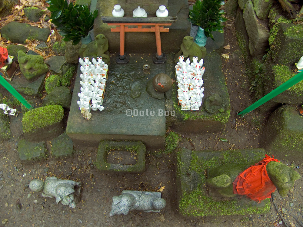 a small ritual altar with fox messenger and gate