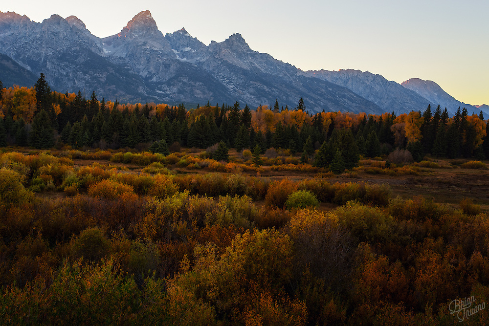 As the sun sets on the far side of the Teton range, a hint of alpine glow lights up the Cathedral Group's peaks.
