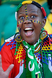 a female South African fan, face painted dances during the players warm up, France v South Africa, FIFA World Cup 2010 Group A, Free State Stadium, Bloemfontein, South Africa, Date 22062010 Picture by Marc Atkins Mobile +27 8200 97621 (IPS PHOTO AGENCY) - 21 Delisle road - London SE28 0JD- tel: 020 88 55 1 008 - fax: 020 88 55 1037 - ISDN: 020 88 55 1039. / SPORTIDA PHOTO AGENCY