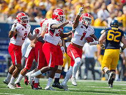 Sep 10, 2016; Morgantown, WV, USA; Youngstown State Penguins cornerback Eric Thompson (1) celebrates with teammates after intercepting a pass during the first quarter against the West Virginia Mountaineers at Milan Puskar Stadium. Mandatory Credit: Ben Queen-USA TODAY Sports