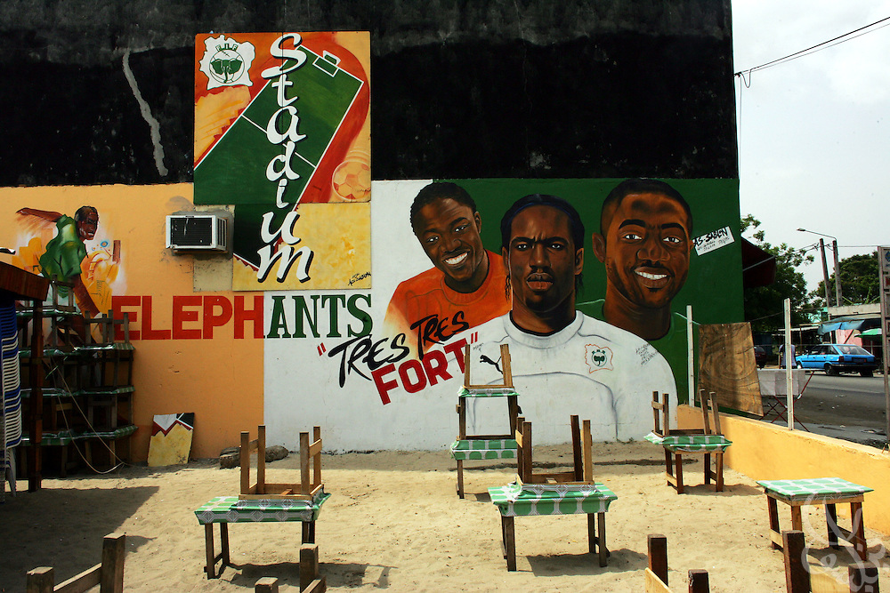 A local cafe is decorated with a national team mural in the Yopoungon  neighborhood of Abidjan, Côte d'Ivoire February 19,2006.   Football is an integral part of the social fabric of the Côte d'Ivoire.
