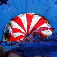 Thomas Wells | Buy at PHOTOS.DJOURNAL.COM<br /> The ground crew starts to inflate the hot air balloon for Wednesday's Festival in the Field at Robins Field in Tupelo.