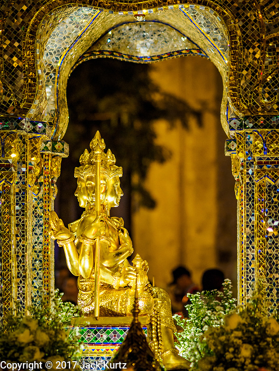 09 NOVEMBER 2017 - BANGKOK, THAILAND: The Phra Phrom Statue at the Erawan Shrine on the 61st anniversary of the shrine's dedication. The Erawan Shrine is one of the most popular shrines in Bangkok. It was dedicated on November 9, 1956, after a series of construction accidents at what was then the Erawan Hotel (since torn down and replaced by the Grand Hyatt Erawan Hotel). The statue in the shrine is Phra Phrom, the Thai representation of the Hindu god of creation Brahma. It is a Hindu shrine popular with Thai and Chinese Buddhists because it is thought that making an offering to the Phra Phrom will bring good fortune.    PHOTO BY JACK KURTZ