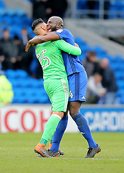 Cardiff City's Souleymane Bamba celebrates the 1-0 win with Goalkeeper Neil Etheridge at full time during the Sky Bet Championship match at The Cardiff City Stadium.