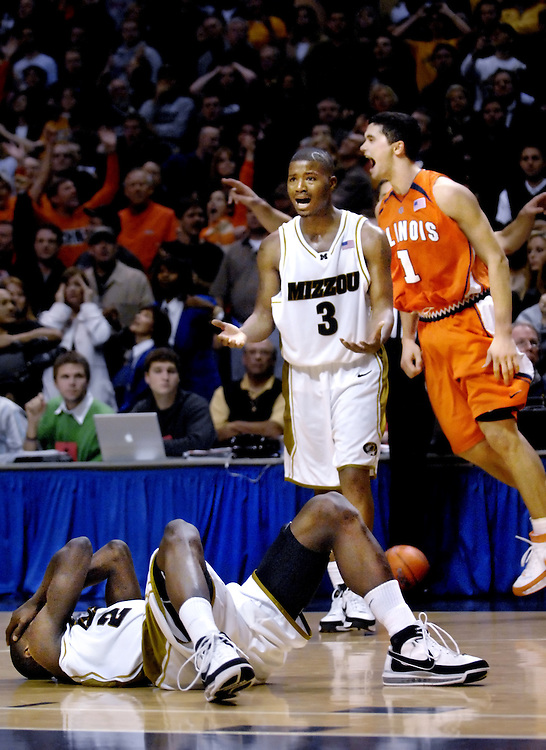 Stefhon Hannah, center, looks to the bench in disbelief, as Illinois' Trent Meacham, right, celebrates as the final second counts down at the 2007 Bragging Rights game in St. Louis.  Keon Lawrence, floor, had possession in the closing seconds only to lose his footing.  The Illini won their 8th consecutive Bragging Rights game 59-58.