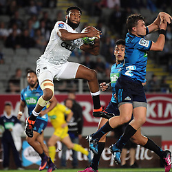 Lukhanyo Am beats Blues fullback Michael Collins (right) to a high ball during the Super Rugby match between the Blues and Sharks at Eden Park in Auckland, New Zealand on Saturday, 31 March 2018. Photo: Dave Lintott / lintottphoto.co.nz