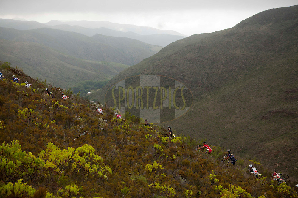 ROBERTSON, MARCH 26 2012 - Riders climb to Hangman's Tree during stage 1 of the 2012 Absa Cape Epic Mountain Bike stage race held from Robertson Primary School in Robertson, South Africa on the 26 March 2012..Photo by Gary Perkin/Cape Epic/SPORTZPICS