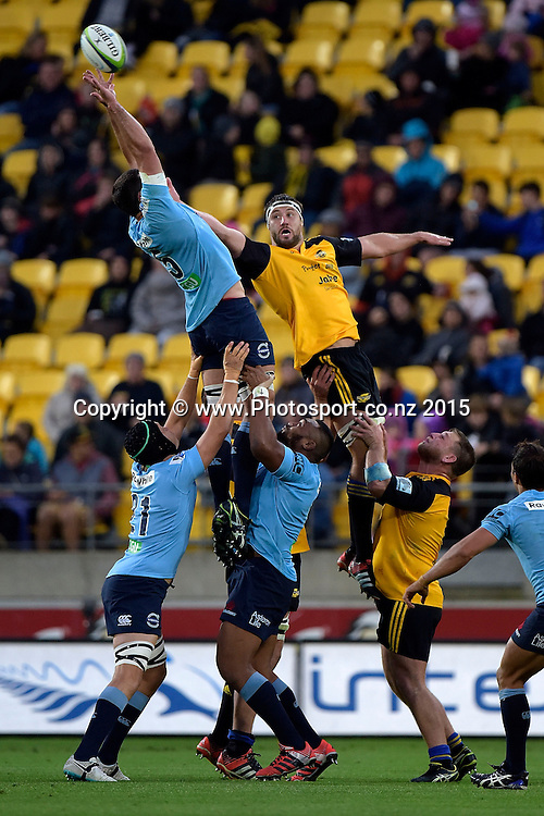 Hurricanes' lock Jeremy Thrush (Top R) jumps for the line out ball with Waratahs' captain David Dennis (Top L) during the Super Rugby - Hurricanes v Waratahs rugby union match at the Westpac Stadium in Wellington on Saturday the 18th of April 2015. Photo by Marty Melville / www.Photosport.co.nz