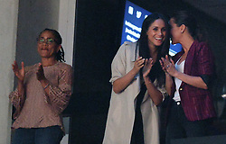 Meghan Markle, centre, watches the closing ceremonies of the Invictus Games with her mother Doria Radlan, left, in Toronto, ON, Canada, on Saturday, September 30, 2017. Photo by Nathan Denette/CP/ABACAPRESS.COM