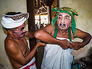 19 JULY 2016 - TAMPAKSIRING, GIANYAR, BALI, INDONESIA:  Dancers get into their costumes on the first day of a ceremony to honor the anniversary Pura Agung temple, one of the most important Hindu temples on Bali. This year's ceremony is the most important in years because it falls on the 50 year cycle of the temple's founding. This year's ceremony lasts for 11 days.     PHOTO BY JACK KURTZ