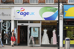 © London News Pictures. 14/07/2013. COPY AVAILABLE BELOW…. ageuk charity shop on Orpington High Street, Kent. Orpington High street now has 12 charity shops  in one short stretch, with Cancer Research UK having two shops on different sides of the high street almost facing each other.  COPY AVAILABLE HERE:  http://tinyurl.com/nhtxtyd<br /> <br /> Photo credit :Grant Falvey/LNP
