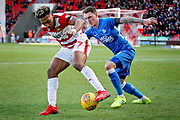 Peterborough Utd forward Callum Cooke jockeys Doncaster Rovers forward Mallik Wilks during the EFL Sky Bet League 1 match between Doncaster Rovers and Peterborough United at the Keepmoat Stadium, Doncaster, England on 9 February 2019.