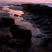 Rain water flows from the cliffs that border Aguda Beach and joins the sea water left on tidal pools, to finally flow to the ocean