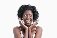 Portrait of a surprised young woman shouting over white background