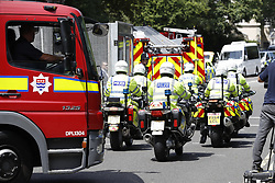 © Licensed to London News Pictures. 12/07/2018. London, UK. Police and a fire engine enter a closed off section of Regent's Park surrounding the US Ambassador's residence where  President Trump will stay later.  Photo credit: Peter Macdiarmid/LNP