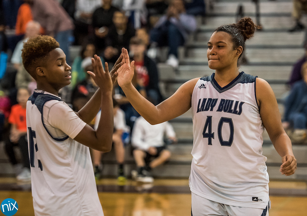 Hickory Ridge's Gabby Smith (40) and Nia Daniel (12) celebrate winning the South Piedmont Conference championship  against Central Cabarrus at Cox Mill High School Friday night. The Ragin' Bulls defeated the Vikings 70-50 to win the championship.