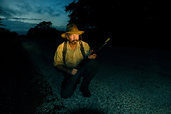 Dairen Simpson prepares to check the traps at sunrise near the villae of Mnolela, Tanzania. Ami Vitale