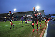 Newport  Mickey Demetriou (28) and  Newport  David Pipe (2) lead the warm ups before the The FA Cup 4th round match between Newport County and Tottenham Hotspur at Rodney Parade, Newport, Wales on 27 January 2018. Photo by Gary Learmonth.