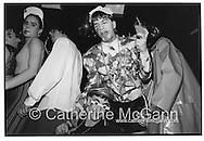 Michael Alig, holding a drink and dancing with friends at his birthday party at club Red Zone, New York City, 1989<br /> <br /> Copyright Catherine McGann / All Rights Reserved<br /> www.catherinemcgann.com<br /> catherinemcgann@gmail.com