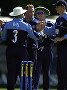.14/07/2002 - Sport - Cricket- Norwich Union League..Middlesex Crusaders vs Gloucester Gladiators.James Averis (no hat) is congratulated by team mates after taking the wicket of  Andy Strauss  caught jack Russell.