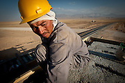 An Uzbek worker builds a signal station for the new railroad near Mazar-e-Sharif, Afghanistan.