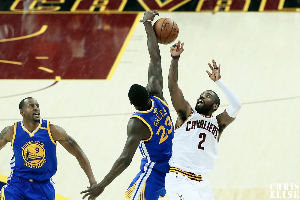 07 June 2017: Cleveland Cavaliers guard Kyrie Irving (2) is blocked by Golden State Warriors forward Draymond Green (23) during the Golden State Warriors 118-113 victory over the Cleveland Cavaliers, in game 3 of the 2017 NBA Finals, at  the Quicken Loans Arena, Cleveland, Ohio, USA.