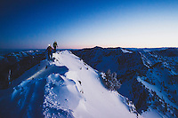Caroline Gleich and Rob Lea hike the wintery east ridge of Mt Superior in the early morning twilight, Wasatch Mountains.