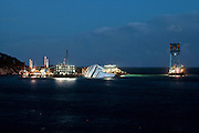 """Italy - Isola del giglio. The wreck of the ship """"Costa Concordia"""" lies on the coast of Isola del Giglio. .About a year after the tragedy (13 January 2011), continue the removal of the ship entrusted to the consortium Italian-American Micoperi - Titan."""