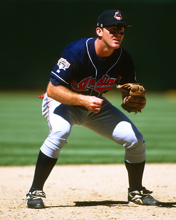 OAKLAND - 1995:  Jim Thome #25 of the Cleveland Indians fields during an MLB game against the Oakland Athletics at he Oakland-Alameda County Colosseum.  Thome played for the Indians from 1991-2002.  (Photo by Ron Vesely)
